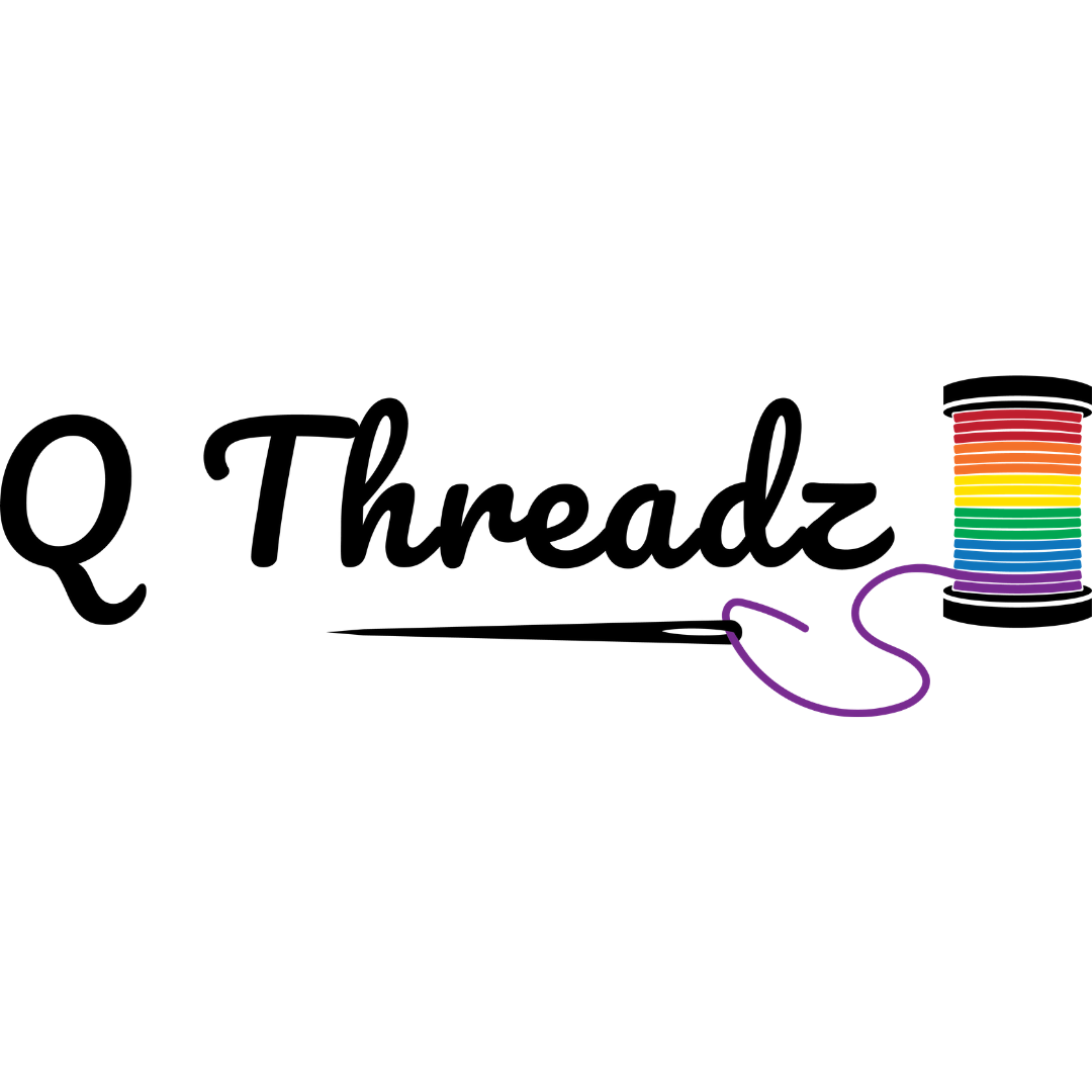 """The words """"Q Threadz"""" are written in black loopy font on w white background. At the end of the word, sits a rainbow spool of thread. The thread at the bottom of the spool is purple and is threaded through a long slack needle that underlines the words."""