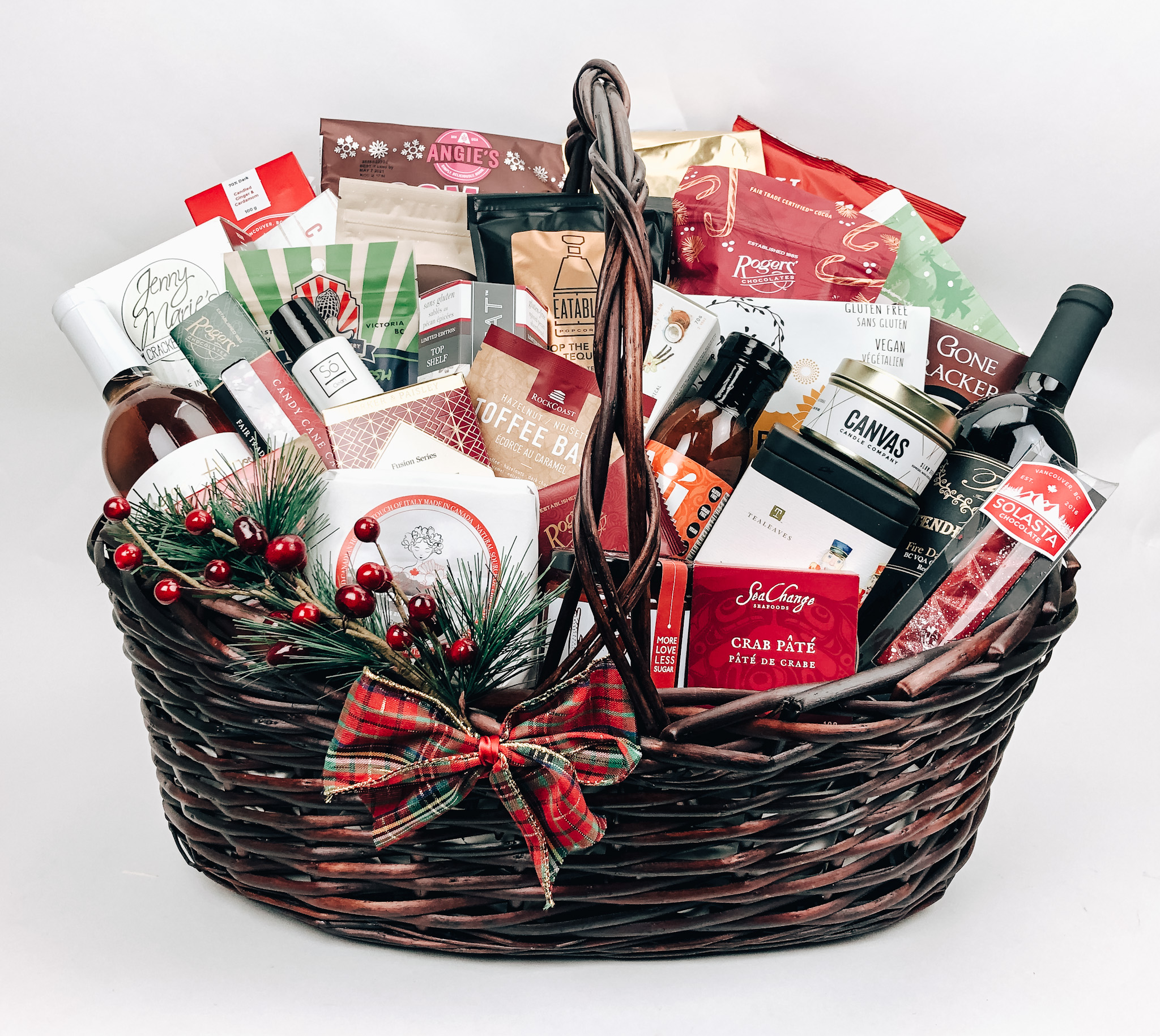 A gift basket filled with various items on a white background